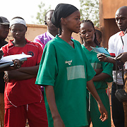 Under the control of the two captains, the checking list of the two team players, before the match between Les Amazones of Bacodjikoronì and Malisadio team, both from Bamako