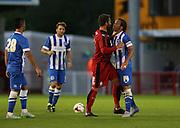 Simon Walton and Inigo Calderon clash during the Pre-Season Friendly match between Crawley Town and Brighton and Hove Albion at the Checkatrade.com Stadium, Crawley, England on 22 July 2015.