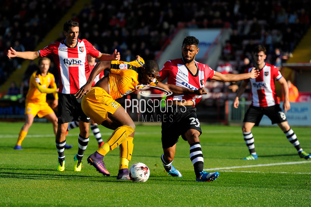 Uche Ikpeazu (26) of Cambridge United battles for possession in the 18 yard box with Luke Croll (29) of Exeter City  during the EFL Sky Bet League 2 match between Exeter City and Cambridge United at St James' Park, Exeter, England on 22 October 2016. Photo by Graham Hunt.