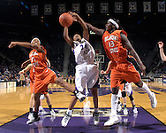 Kansas State forward Naytanda Smith battle for a rebound with Oklahoma State's Rashidat Sadiq (13) and Danielle Green (31), during first half action at Bramlage Coliseum in Manhattan, Kansas, February 28, 2007.  Oklahoma State beat K-State 64-55.