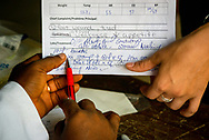 The pharmacist reviews a prescription on the first day of the LCMS Mercy Medical Team on Monday, May 7, 2018, in the Yardu village outside Koidu, Sierra Leone, West Africa. LCMS Communications/Erik M. Lunsford
