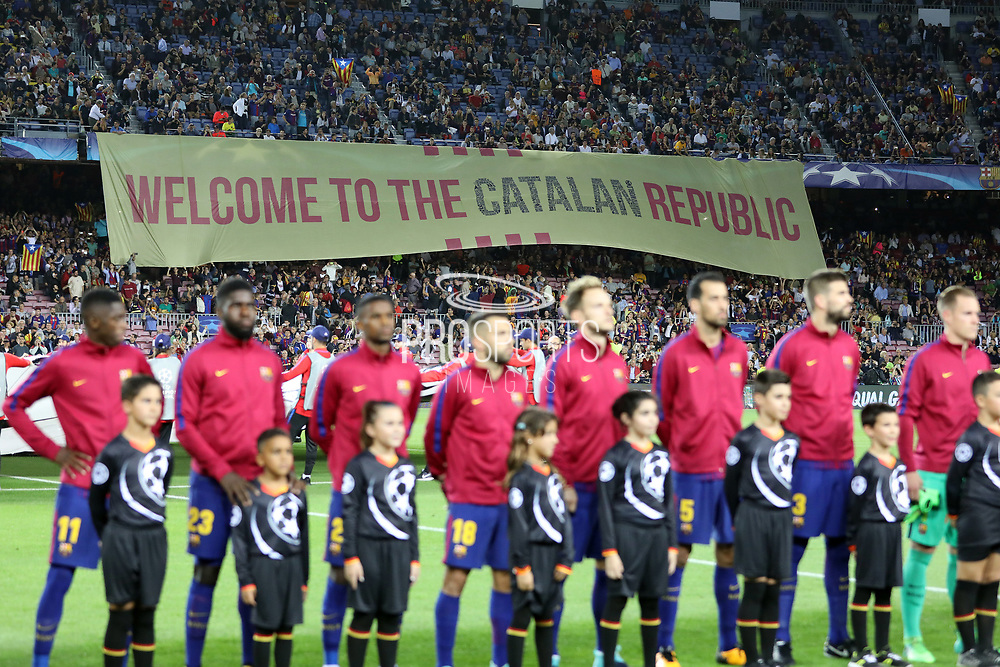 Fans of FC Barcelona display a giant banner reading Welcome