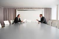 Businessmen discussing in boardroom