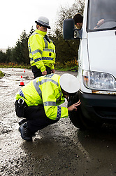 Pictured: PC Alan Meikle and PC Elaine Fraser worked as a team to carry out the checks.<br /> <br /> Police Scotland luanched a series of vehicle checks to be carried out by the Lothians and Scottish Borders Division Road Policing Unit. Inspector Roddie MacMillan oversaw the checks which are part of activity taking place across Scotland this week to help drivers get ready for winter, ensuring their vehicles are maintained and they are aware of the different hazards the changing seasons and weather can bring. <br /> <br /> Ger Harley | EEm 18 October 2016