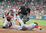 Jun 22, 2016; Houston, TX, USA; Los Angeles Angels catcher Jett Bandy (47) slides home safely while Houston Astros catcher Jason Castro (15) applies the tag in the third inning at Minute Maid Park. Mandatory Credit: Thomas B. Shea-USA TODAY Sports