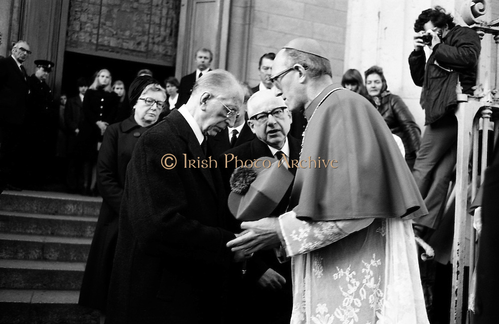 Eamon de Valera is consoled by the Archbishop of Dublin, Dermot Ryan, after the funeral Mass for his wife, Sinead de Valera, in the Pro-Cathedral. Born in 1878, Sinead Bean de Valera wrote many books for children, in English and in Irish, including books of Irish fairy tales.<br />