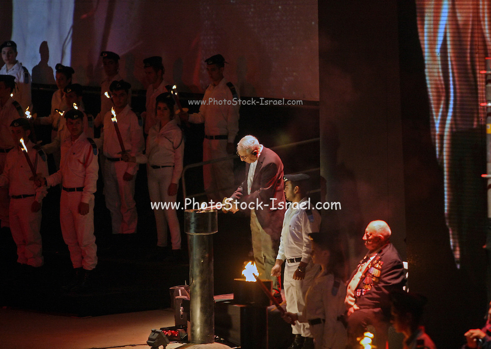 Survivor lights the torch at the Holocaust Martyrs' and Heroes' Remembrance Day ceremony. Kibbutz Lohamei HaGeta'ot (lit. The Ghetto Fighters), Israel on Tuesday April 14th 2015