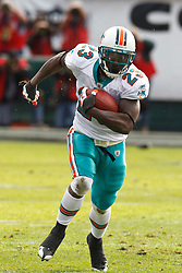 November 28, 2010; Oakland, CA, USA;  Miami Dolphins running back Ronnie Brown (23) rushes up field against the Oakland Raiders during the first quarter at Oakland-Alameda County Coliseum. Miami defeated Oakland 33-17.