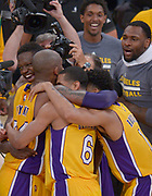 Kobe Bryant is congratulated after scoring his final points from the field. Bryant scored 60 points in his final game as a Los Angeles Laker, as the Lakers defeated the Utah Jazz 101-96. April 13, 2016. Los Angeles, CA.  (Photo by John McCoy/Southern California News Group)