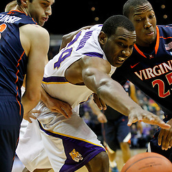 January 2, 2012; Baton Rouge, LA; LSU Tigers forward Storm Warren (24) reaches for a loose ball between Virginia Cavaliers guard Sammy Zeglinski (13) and forward Akil Mitchell (25) during the first half of a game at the Pete Maravich Assembly Center.  Mandatory Credit: Derick E. Hingle-US PRESSWIRE