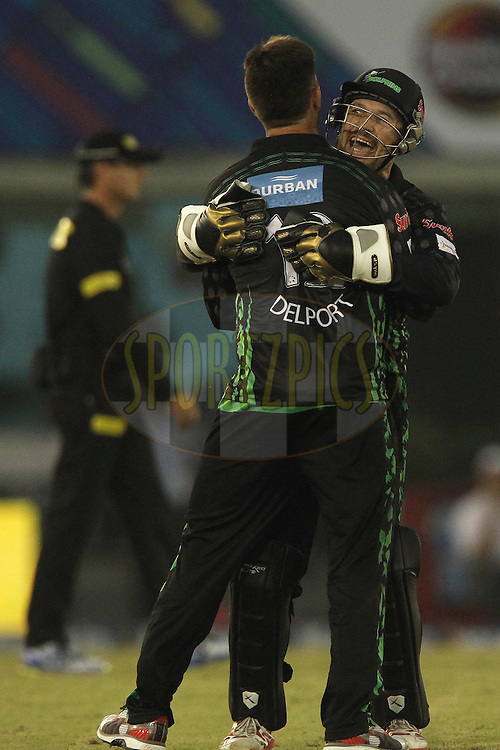 Morne VAN WYK (Captain) of the Dolphins and Cameron DELPORT of the Dolphins celebrate the wicket of Craig SIMMONS of the Perth Scorchers  during match 4 of the Oppo Champions League Twenty20 between the Dolphins and the Perth Scorchers held at the Punjab Cricket Association Stadium, Mohali, India on the 20th September 2014<br /> <br /> Photo by:  Ron Gaunt / Sportzpics/ CLT20<br /> <br /> <br /> Image use is subject to the terms and conditions as laid out by the BCCI/ CLT20.  The terms and conditions can be downloaded here:<br /> <br /> http://sportzpics.photoshelter.com/gallery/CLT20-Image-Terms-and-Conditions-2014/G0000IfNJn535VPU/C0000QhhKadWcjYs