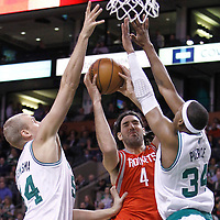 06 March 2012: Houston Rockets power forward Luis Scola (4) goes to the basket between Boston Celtics center Greg Stiemsma (54) and Boston Celtics small forward Paul Pierce (34) during the Boston Celtics 97-92 (OT) victory over the Houston Rockets at the TD Garden, Boston, Massachusetts, USA.
