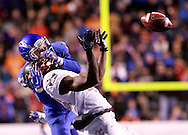 Boise State wide receiver Thomas Sperbeck (82) prevents an interception by UNLV defensive back Kenny Keys (44) at Albertsons Stadium on Friday Nov. 18th, 2016.