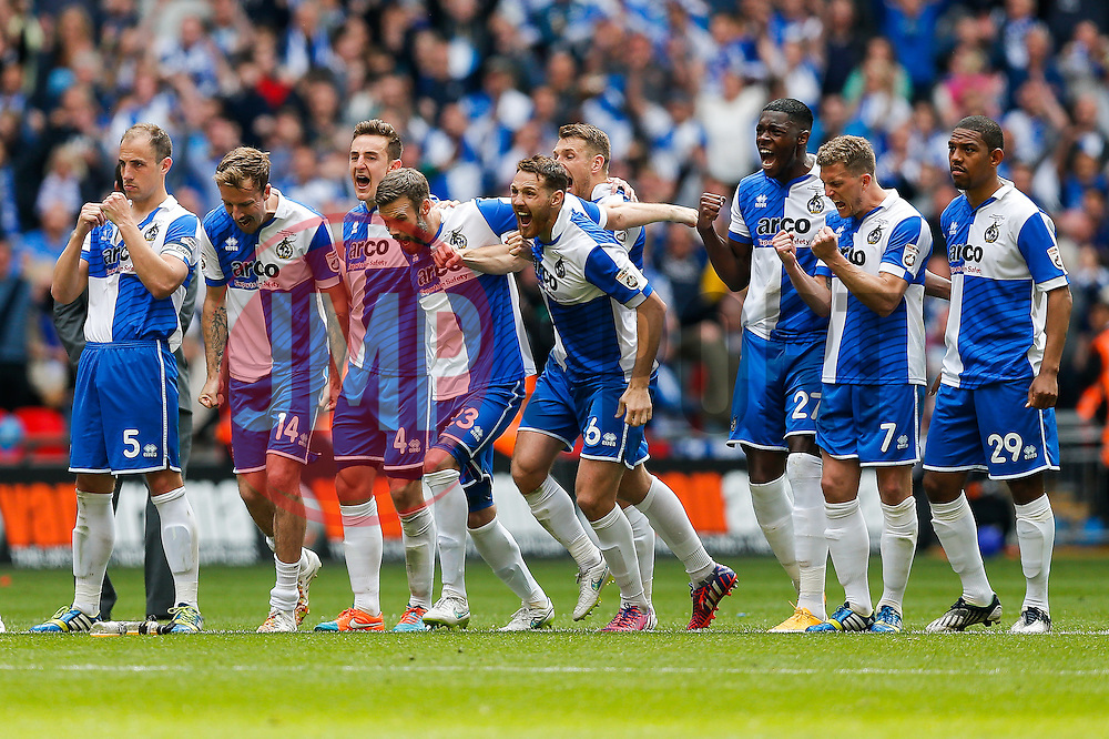 Bristol Rovers celebrate after a miss for Grimsby Town during the penalty shootout - Photo mandatory by-line: Rogan Thomson/JMP - 07966 386802 - 17/05/2015 - SPORT - FOOTBALL - London, England - Wembley Stadium - Bristol Rovers v Frimsby Town - Vanarama Conference Premier Play-off Final.