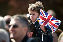 © Licensed to London News Pictures. 20/04/2016.  A young boy waves the union flag as he watches Queen Elizabeth II officially open the new bandstand at Alexandra Gardens in Windosr on the eve of her 90th birthday. Photo credit: Hannah McKay/LNP