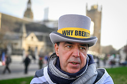© Licensed to London News Pictures. 29/01/2020. LONDON, UK.  Steve Bray of SODEM, wearing a hat bearing the text Why Brexit?, joins anti-Brexit protesters in Parliament Square calling on holding the Boris Johnson, Prime Minister, and his government to account during the upcoming Brexit negotiations.  Britain will formerly leave the European Union at 11pm on 31 January.  Photo credit: Stephen Chung/LNP