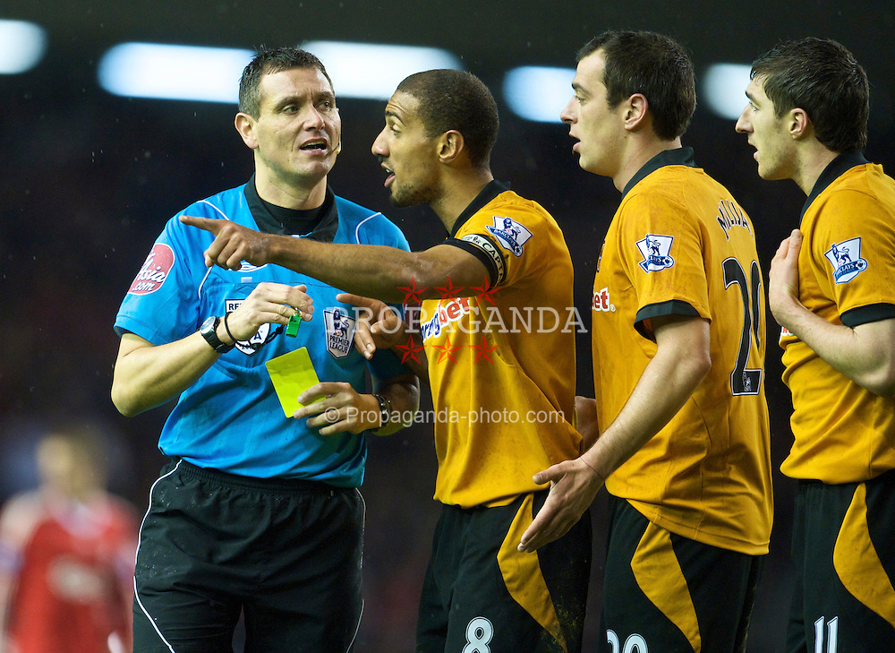 LIVERPOOL, ENGLAND - Saturday, December 26, 2009: Wolverhampton Wanderers' players defend team-mate Stephen Ward as he is sent off by referee Andre Marriner during the Premiership match at Anfield. (Photo by: David Rawcliffe/Propaganda)