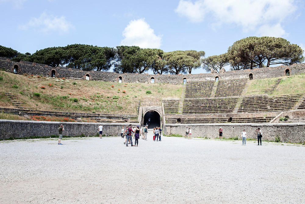 20 May 2017, Pompei, Naples Italy - A group of tourists inside the amphitheater of ancient city of Pompeii.