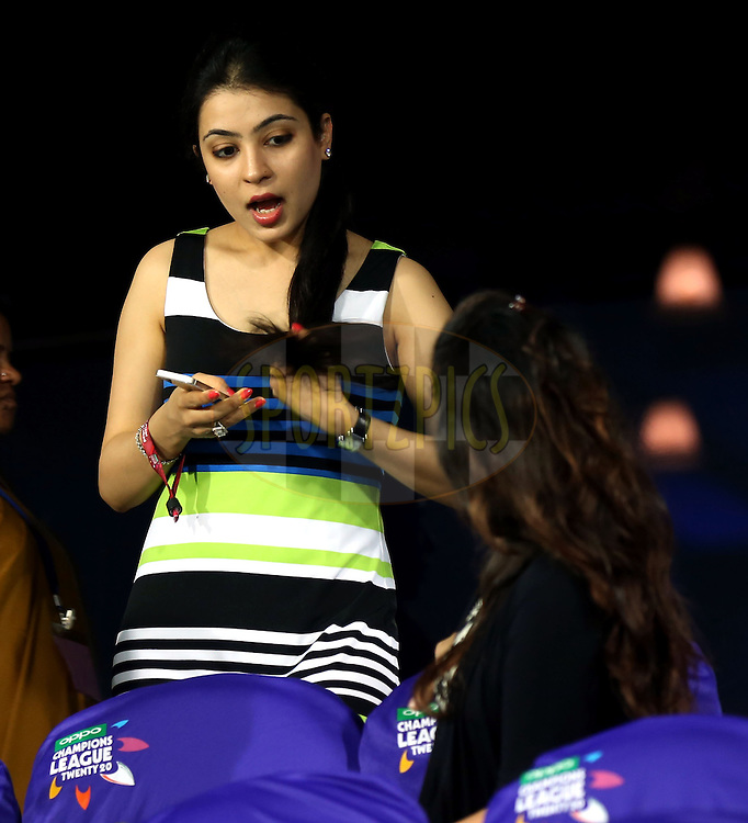 Natasha wife of Gautam Gambhir captain of Kolkata Knight Riders and  Sakshi wife  of M S Dohni captain of  Chennai Super Kings during match 1 of the Oppo Champions League Twenty20 between the Kolkata Knight Riders and the Chennai Superkings held at the Rajiv Gandhi Cricket Stadium, Hyderabad, India on the 17th September 2014<br /> <br /> Photo by:  Sandeep Shetty / Sportzpics/ CLT20<br /> <br /> <br /> Image use is subject to the terms and conditions as laid out by the BCCI/ CLT20.  The terms and conditions can be downloaded here:<br /> <br /> http://sportzpics.photoshelter.com/gallery/CLT20-Image-Terms-and-Conditions-2014/G0000IfNJn535VPU/C0000QhhKadWcjYs
