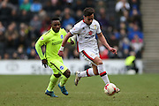 Milton Keynes Dons defender George Baldock (21) goes past Brighton midfielder, winger, Kazenga LuaLua (30) during the Sky Bet Championship match between Milton Keynes Dons and Brighton and Hove Albion at stadium:mk, Milton Keynes, England on 19 March 2016.
