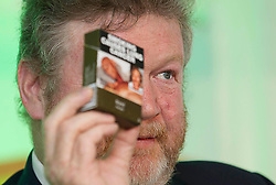 Repro Free: 30/05/2013<br /> Minister for Health Dr. James Reilly is pictured as he gave an emotional speech during the European Week Against Cancer Conference hosted by the Irish Cancer Society where he shared lessons from the Australian experience of the introduction of generic packaging with Jonathan Lieberman, Director of  the McCabe Centre for Law and Cancer, Australia. Picture Andres Poveda
