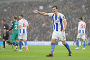 Brighton and Hove Albion defender Lewis Dunk (5) gestures to the assistant referee during the Premier League match between Brighton and Hove Albion and Tottenham Hotspur at the American Express Community Stadium, Brighton and Hove, England on 22 September 2018.