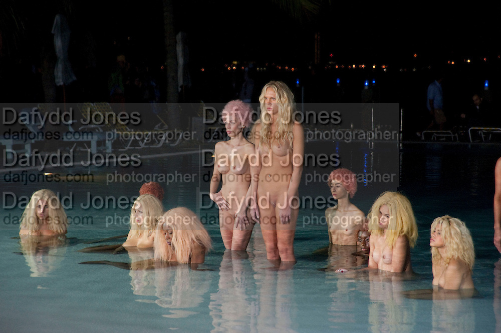 MODELS PERFORMING VANESSA BEECHCROFT INSTALLATION, Neville Wakefield and Playboy host ÒNude as MuseÓ evening art salon. Standard Hotel.  Miami. 4 December 2010. -DO NOT ARCHIVE-© Copyright Photograph by Dafydd Jones. 248 Clapham Rd. London SW9 0PZ. Tel 0207 820 0771. www.dafjones.com.<br />