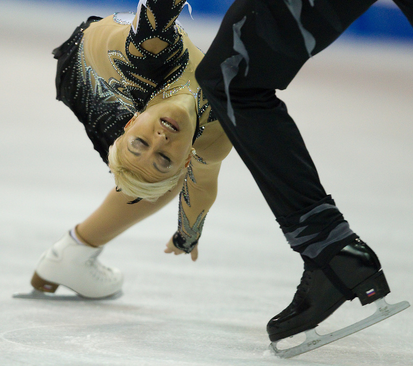 GJR399 -20111029- Mississauga, Ontario,Canada-  Tatiana Volosozhar of Russia and her partner Maxim Trankov  skate to victory in the pairs competition at Skate Canada International, in Mississauga, Ontario, October 29, 2011.<br /> AFP PHOTO/Geoff Robins