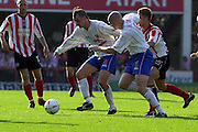 Nationwide Div 2 - Brentford v Hartlepool..Mark Tinkler [4] and Michael Nelson  block out Brentford's Ben May  © Peter Spurrier/Intersport-Images, email images@intersport-images.com. Mob +447973819551