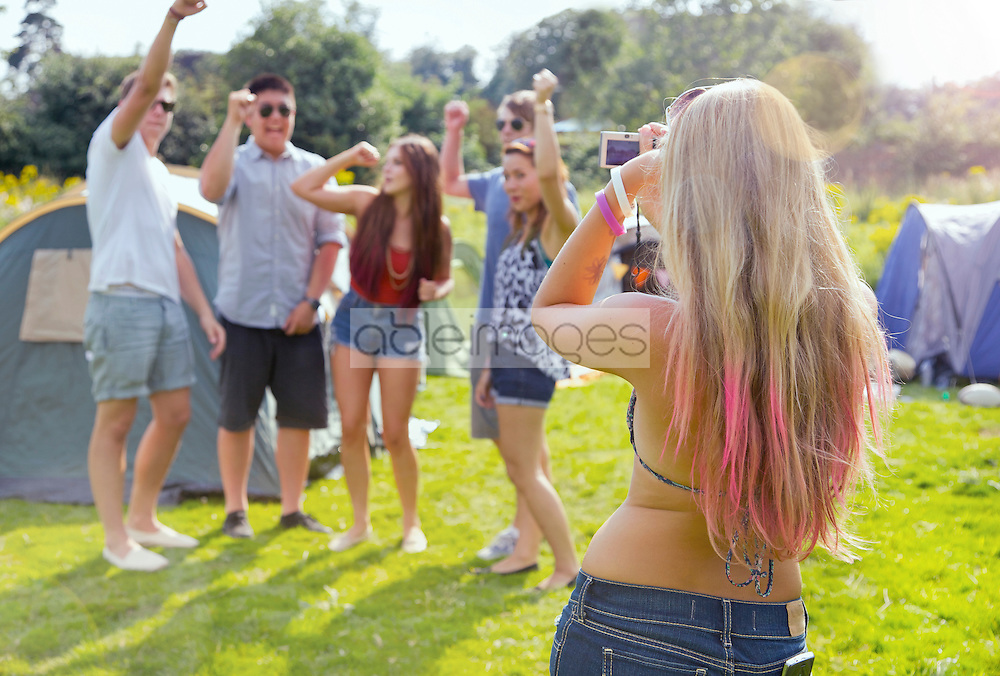 Back View of Woman Taking a Photograph of Group of Teenagers