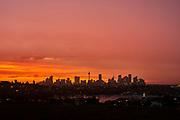 Sydney Skyline at sunset after a thunderstorm.