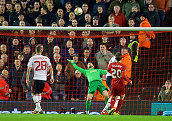 LIVERPOOL, ENGLAND - Thursday, March 10, 2016: Liverpool's Adam Lallana sees his shot saved by Manchester United's goalkeeper David de Gea during the UEFA Europa League Round of 16 1st Leg match at Anfield. (Pic by David Rawcliffe/Propaganda)