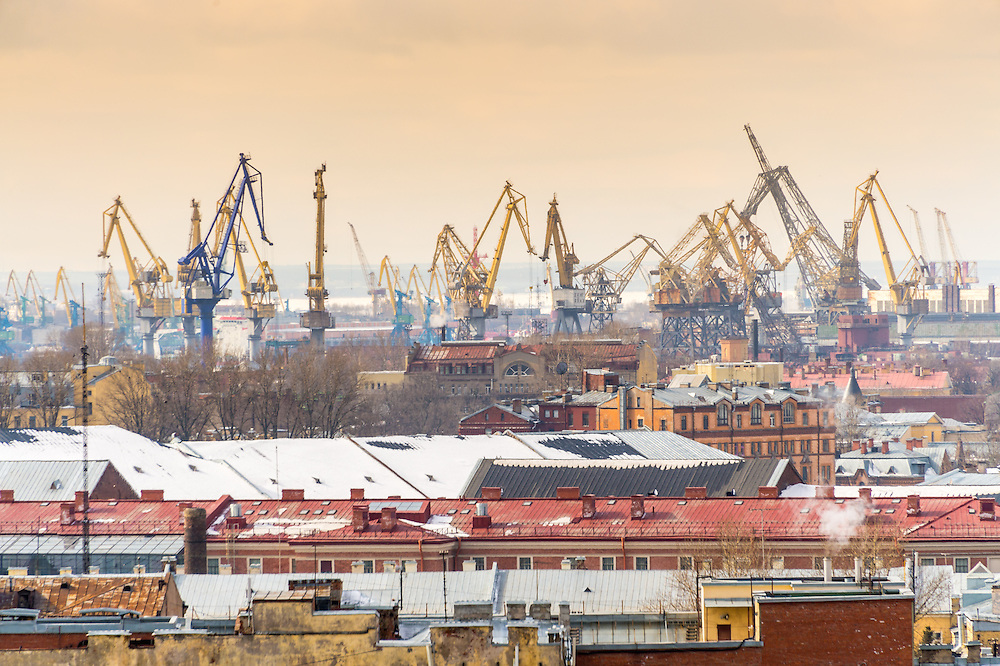 Aerial view of Saint Petersburg from Saint Isaac's Cathedral with port cranes.