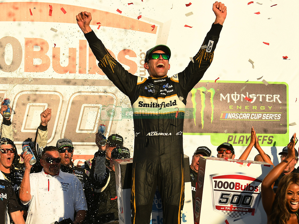 October 14, 2018 - Talladega, AL, U.S. - TALLADEGA, AL - OCTOBER 14: Aric Almirola, Stewart-Haas Racing, Ford Fusion Smithfield Bacon For Life (10) celebrates in Victory Lane after winning during the 1000Bulbs.com 500 on October 14, 2018, at Talladega Superspeedway in Tallageda, AL.(Photo by Jeffrey Vest/Icon Sportswire) (Credit Image: © Jeffrey Vest/Icon SMI via ZUMA Press)