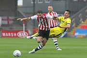 Aaron Martin and Kevin Dawson during the EFL Sky Bet League 2 match between Exeter City and Cheltenham Town at St James' Park, Exeter, England on 22 September 2018.