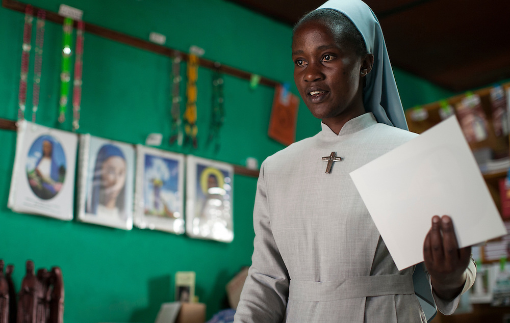 Sister Cecile works in The Shrine of Our Lady of Sorrows gift shop in Kibeho, Rwanda. This is the only sanctioned Marian sanctuary in Africa. Kibeho's overseers and the Rwandan government hope this place will become a top tourism site. Three young Rwandan women had visions of Mary, the first vision coming to Alphonsine Mumureke, then 16, on Nov. 28, 1981.<br /> <br /> Photographed on Sunday, October 26, 2014.<br /> <br /> Photo by Laura Elizabeth Pohl