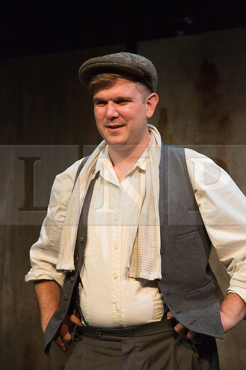 © Licensed to London News Pictures. 28/07/2015. London, UK. Pictured: playwright and actor Kieran Knowles. World premiere of the play Operation Crucible at the Finborough Theatre. The play commemorates the 75th anniversary of the Sheffield Blitz and the 70th anniversary of the end of the Second World War with four men trapped in the rubble. The play by Kieran Knowles and directed by Bryony Shanahan runs at the Finborough Theatre from 28 July to 22 August 2015. With Salvatore D'Aquilla, Kieran Knowles, Paul Tinto and James Wallwork. Photo credit: Bettina Strenske/LNP