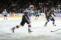 KELOWNA, CANADA, FEBRUARY 17: Brett Lyon #21 of the Kelowna Rockets takes a shot against the Calgary Hitmen at the Kelowna Rockets on February 17, 2012 at Prospera Place in Kelowna, British Columbia, Canada (Photo by Marissa Baecker/Shoot the Breeze) *** Local Caption ***