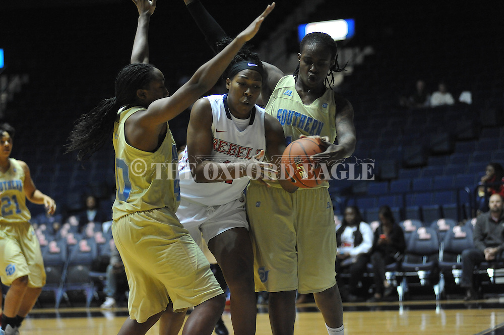 "Ole Miss forward Shequila Joseph (11) vs. \s40\ and Southern University Jaguars forward/center Jasmine Jefferson (15) at the C.M. ""Tad"" Smith Coliseum in Oxford, Miss. on Thursday, November 20, 2014. (AP Photo/Oxford Eagle, Bruce Newman)"