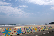 The sea wall at Toyoma Beach has been painted with flowers by volonteers to cheer the place up. The mayority of the houses were swept away with the tsunami, Iwaki, Fukushima Prefecture, Japan.