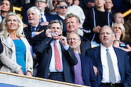 Millwall Chairman, John Berylson (centre) enoys a cigar to celebrate staying in the Championship after the Sky Bet Championship match at The Den, London<br /> Picture by David Horn/Focus Images Ltd +44 7545 970036<br /> 03/05/2014