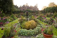 Double borders of Dahlias in the sunken garden at Chenies Manor House, Chenies, Rickmansworth, Buckinghamshire, UK