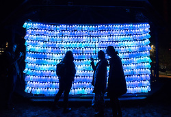 "© Licensed to London News Pictures. 27/02/2020. Bristol, UK. Bristol Light Festival; the artwork ""Milk Bottle"" at Castle Park, by Jack Wimperis to raise awareness about single use plastics, with 600 one pint hanging plastic milk bottles illuminated with LEDs inside. This is the launch of the first ever Bristol Light Festival, hosted by Bristol City Centre BID. Internationally renowned artists and local talent lighting up the city with a series of installations this weekend. Photo credit: Simon Chapman/LNP."
