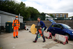 © Licensed to London News Pictures. 13/05/2020. London, UK. A man with household rubbish at Western Road Reuse & Recycling Centre in Haringey, north London which opened this morning after seven weeks of the coronavirus lockdown. Photo credit: Dinendra Haria/LNP