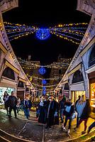 Shops along the Rialto Bridge during Venice Carnival, Venice, Italy.
