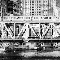 Chicago Lake Street Bridge L Train black and white picture of a train crossing the over the Chicago River in downtown Chicago. Panoramic picture ratio is 1:3.