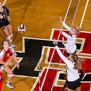 26 August 2016: The San Diego State Aztecs took on the Marist Red Foxes to open up the season.  OH Hannah Turnlund (7) and MB Emma Fuzie (12) go up for a block in the third set. The Aztecs swept the Red Foxes 3-0 in their opening match of the Aztec Invitational at Peterson Gym on the campus of SDSU. www.sdsuaztecphotos.com