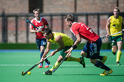 Australia's Jamie Dwyer is shadowed by Dan Fox of England. England v Australia, Bisham Abbey, Marlow, UK on 25 May 2014. Photo: Simon Parker