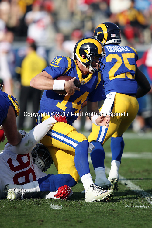 Los Angeles Rams quarterback Sean Mannion (14) gets sacked by San Francisco 49ers defensive tackle Sheldon Day (96) for a loss of 9 yards in the second quarter during the 2017 NFL week 17 regular season football game against the San Francisco 49ers, Sunday, Dec. 31, 2017 in Los Angeles. The 49ers won the game 34-13. (©Paul Anthony Spinelli)