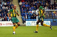 Photograph:Scott Heavey.<br />Gillingham v West Bromwich Albion. Nationwide Duvision one. 04/10/2003.<br />Neil Clement celebrates making it 0-2.